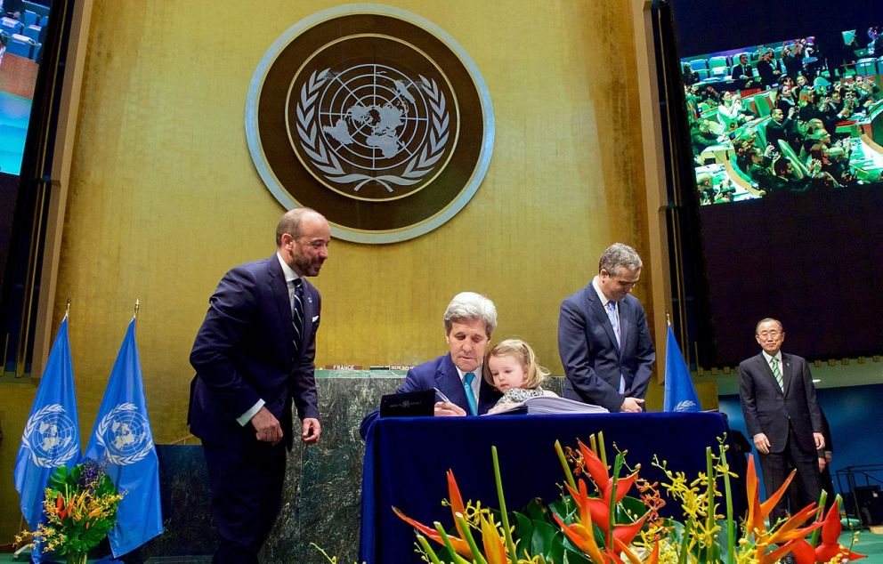 John Kerry signing the Paris Agreement for the United States